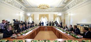 Russian President Vladimir Putin meets with the heads of Russian and foreign news agencies in St. Petersburg on Thursday, June 1